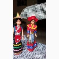 Китайские куклы провинции Сычуань в национальных костюмах